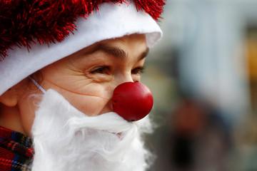 A woman dressed as Santa Claus takes part in the charity Santa Fun Run in Riga