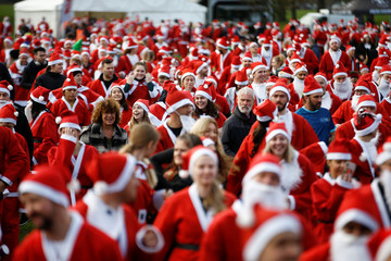 Competitors prepare to take part in the London Santa Run in Victoria Park, London