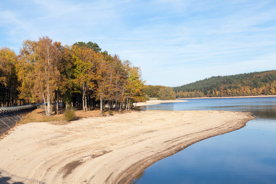Lac de Vassiviere, Plateau de Millevaches, Nouvelle-Aquitaine, France with colourful  autumn foliage  in evening light