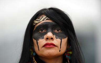 Indigenous and activists protest at Repsol headquarters as COP25 climate summit is held in Madrid