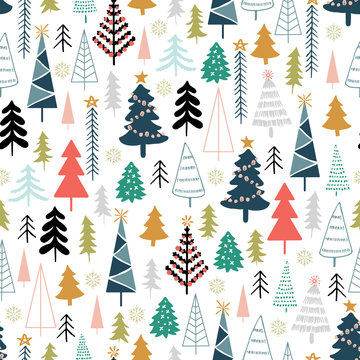 Winter seamless pattern with christmas trees, spruce woods on white background. Surface design for textile, fabric, wallpaper, wrapping, giftwrap, paper, scrapbook and packaging.
