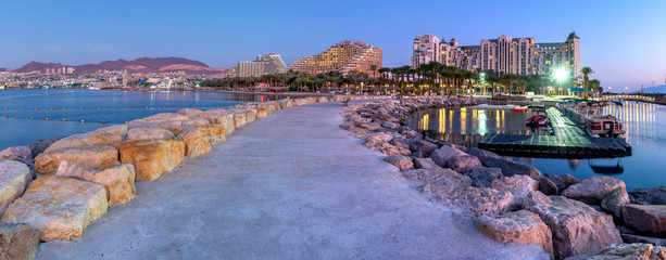 Night panoramic view from public walking pier on central beach and promenade of Eilat - famous tourist resort and recreational city in Israel Wall mural