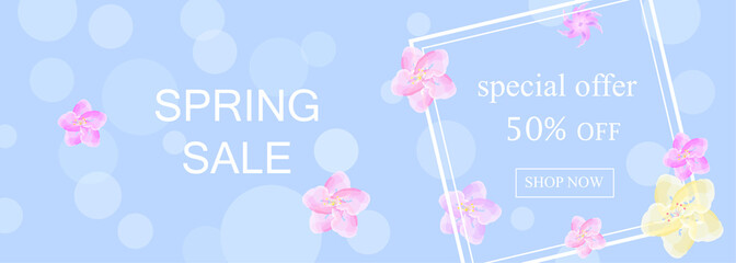 special offer spring sale banner on light blue background and cherry blossom