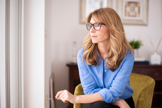 Portrait of thinking middle aged woman