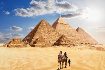 The Great Pyramids of Giza and the bedouins under the desert sun, Egypt