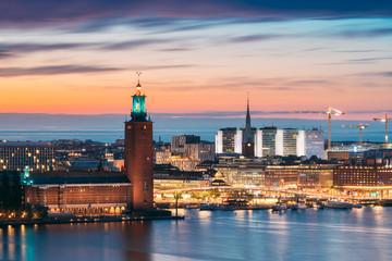 Stockholm, Sweden. Scenic Skyline View Of Famous Tower Of Stockholm City Hall And St. Clara Or Saint Klara Church. Popular Destination Scenic View In Sunset Twilight Dusk Lights. Evening Lighting Fototapete