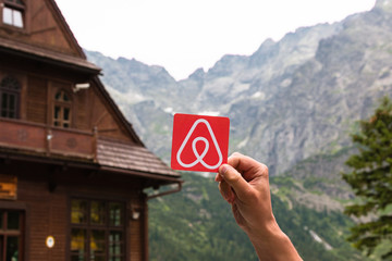 Minsk, Belarus - July, 2017: Travel around the world with Airbnb. Logo Airbnb. Home concept. Big house.