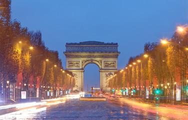 The famous Triumphal arch and Champs Elysees avenue,Paris.