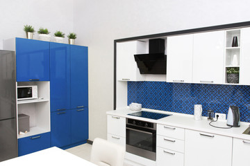 Kitchen interior in light blue colors. Scandinavian style, color 2020 classic blue pantone