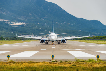 Sunny view of airplane taking off from airport of Tivat, Montenegro.