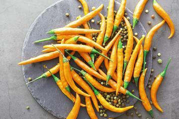 Aluminium Prints Hot chili peppers Hot orange pepper. Chilean pepper on a black.