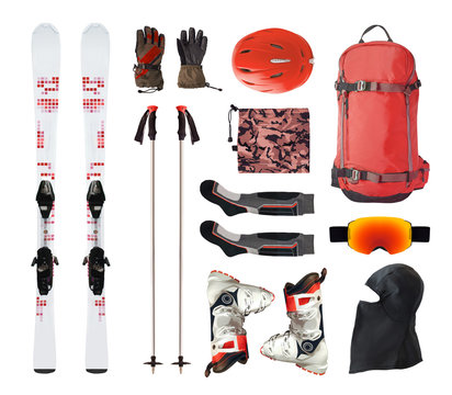 Flat lay of mountain ski equipment and alpine accessories. Helmet, boots, ski goggles, etc. isolated on white background