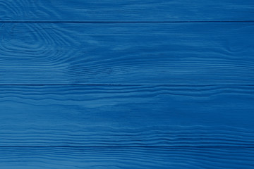 Classic blue color of 2020 wooden board textured background