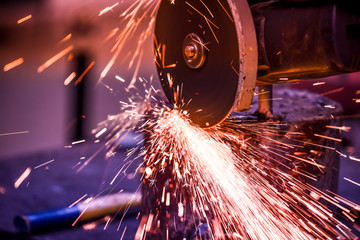 technician working with electric arc welding