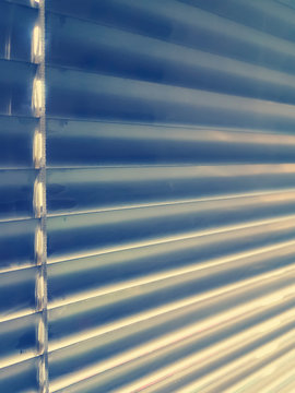 Sunblinds Silver aluminum louver on window horizontal pattern. Shutters On glass In The Office or home  interior