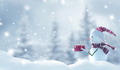 Wall Mural - Merry Christmas and happy New Year greeting card with copy-space.Happy snowman standing in Christmas landscape.Snow background.Winter fairytale.