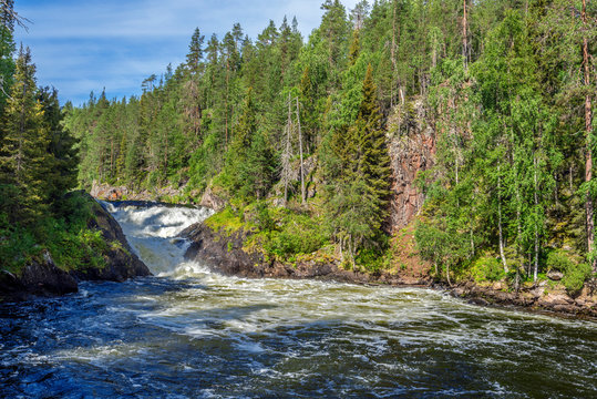 The flow of Yattumutka river and the waterfall at Jyrava view point in Oulanka National Park. Pieni Karhunkierros Trail in Finland.