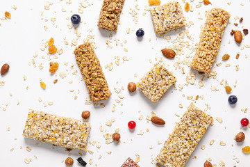 Different granola bars on white background