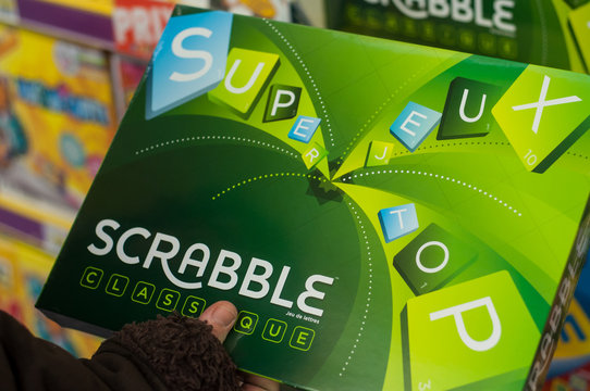 Mulhouse - France - 7 December 2019 - Closeup of Scrabble game in hand of woman in a toys store