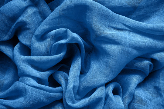 Blue cotton fabric background. Color of the year 2020 classic blue toned.