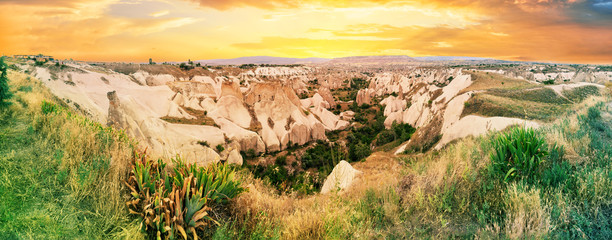 Photo Stands Melon Valley with sandy cliffs in Cappadocia