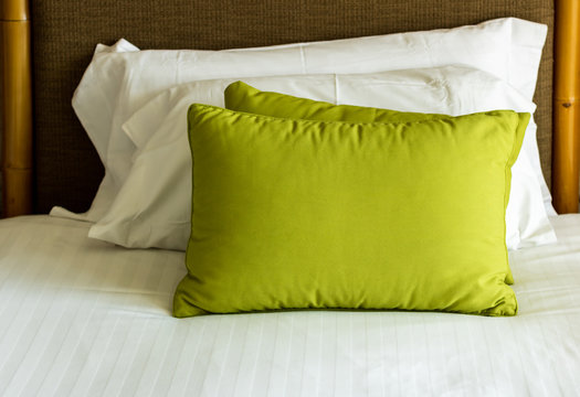 Green and White pillows on a bed Comfortable soft pillows on the bed