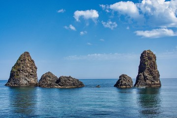 Foto auf Acrylglas Blau Jeans Cyclops island, basaltic rock fomation in Aci Trezza, Catania, Sicily, Italy.