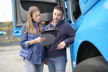 Logistics manager controlling truck driver schedule