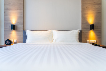 White comfortable pillow on bed decoration interior