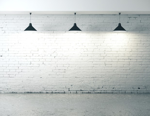 Blank brick wall with ceiling lamp