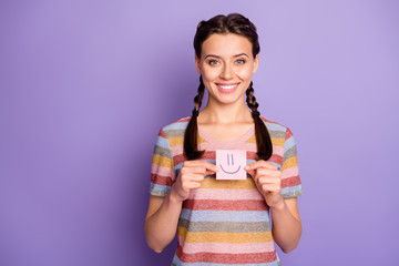 Photo of pretty lady holding paper emoticon good mood showing positive painted emotion wear casual striped t-shirt isolated pastel purple color background