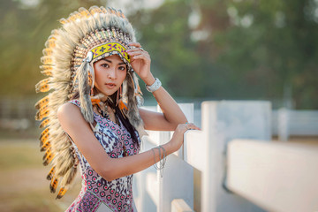 Beautiful American Indian woman in the farm horse.