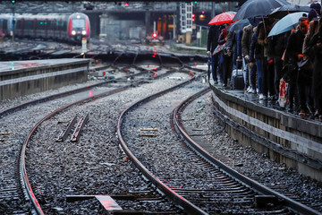 Commuters walk on a platform at Gare Saint-Lazare train station in Paris