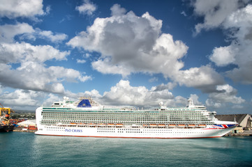 Big cruise ship P&O Cruises in harbour with beautiful waterscape and cloudy sky, horizontal picture