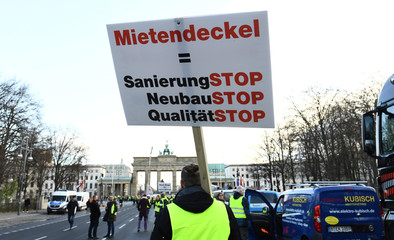 German construction workers protest against rent control in Berlin