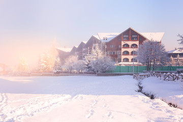 Bansko, Bulgaria winter resort foggy snow panorama with ski slope, wooden house