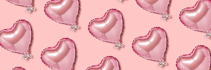 Pink air balloon in the shape of a heart on a pink background. Pattern. Love concept, valentines day. Banner. Flat lay, top view