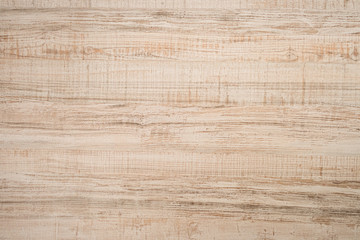 Textured wooden plank of light color as background