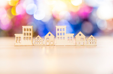 Wooden house craft over blrred colorful bokeh background