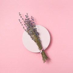 Organic lavender branch on a ceramic plate.