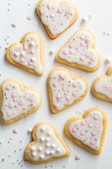 Flat lay of cookies hearts with icing and decorated for Valentine's Day, white background. Valentine's day concept.