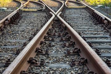 Spoed Fotobehang Spoorlijn Railroad track with switch and wooden ties
