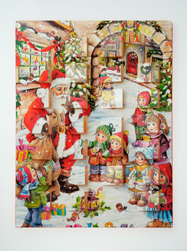 Empty chocolate box made by Lidl Stiftung & Co (brand). Advent calendar with Christmas design for children.There are compartments for chocolate behind small windows.