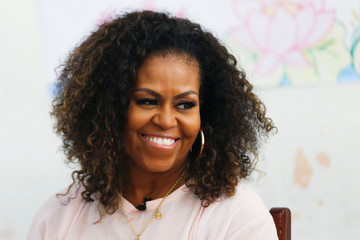 Former first lady Michelle Obama attends the Girls Opportunity Alliance program with Room to Read at the Can Giuoc Highschool in Long An province