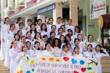 Former first lady Michele Obama poses with students from the Can Giuoc Highschool during the Girls Opportunity Alliance program with Room to Read, in Long An province