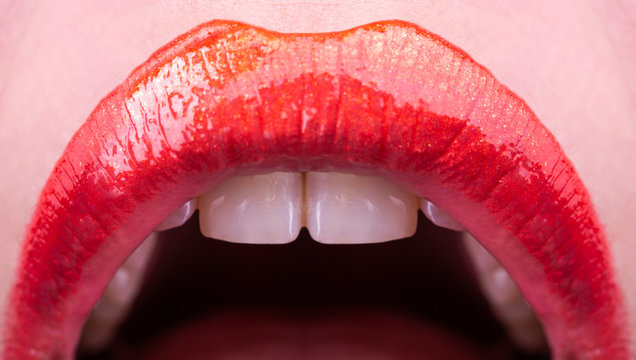 Lips with teeth. Beautiful female open mouth. Luxury red lipstick for holiday. Sexy woman sign.