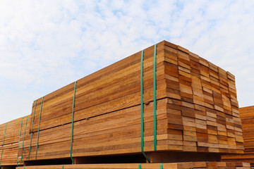 Pallet with a pile of lumber, packed for sale.