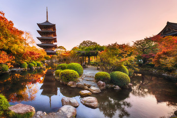Ancient wooden pagoda Toji temple in autumn garden, Kyoto, Japan.