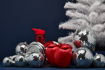 Sports equipment and  Christmas ornaments. Fitness New Year and Christmas background