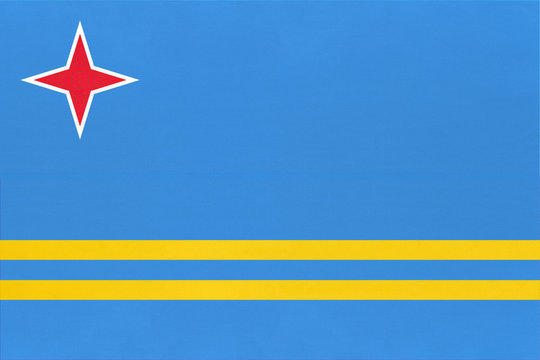 Aruba national fabric flag textile background. State official caribbean sign.